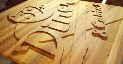 carved cedar sign
