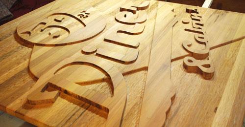 carved cedar sign