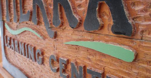 carved wood sign