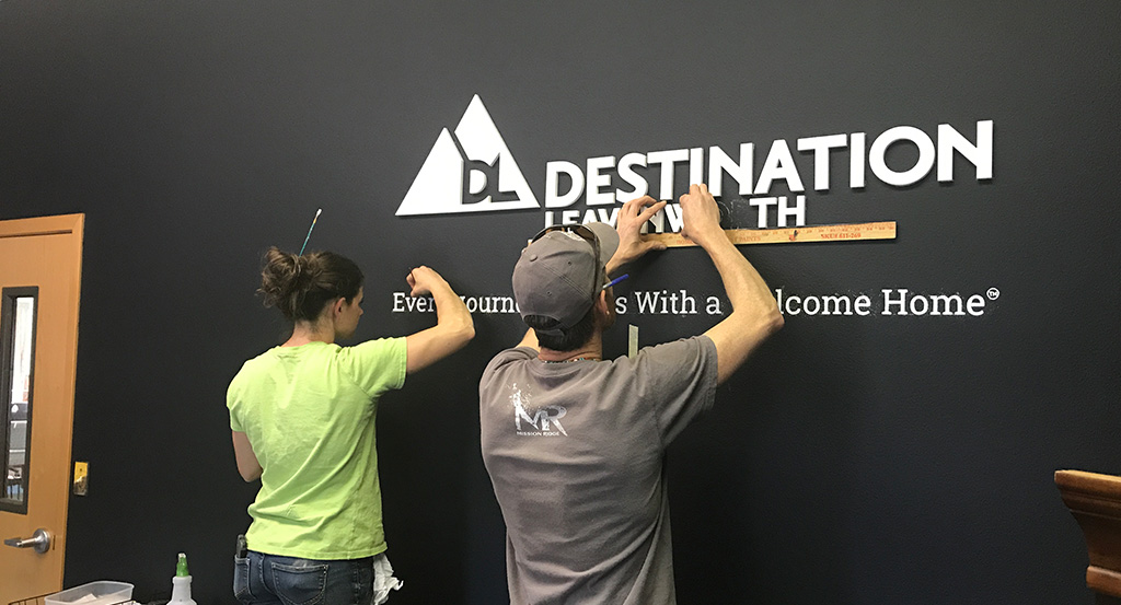 Installing-sign-letters-on-wall